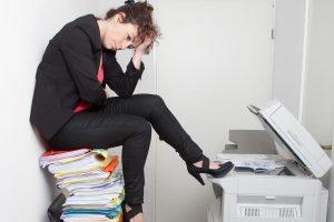 girl frustrated with broken copier